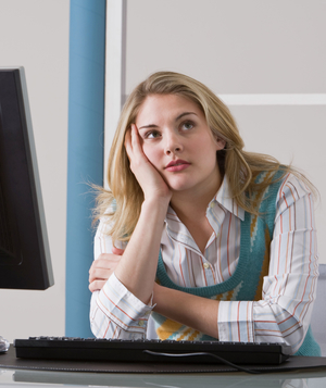 Woman daydreaming at desk