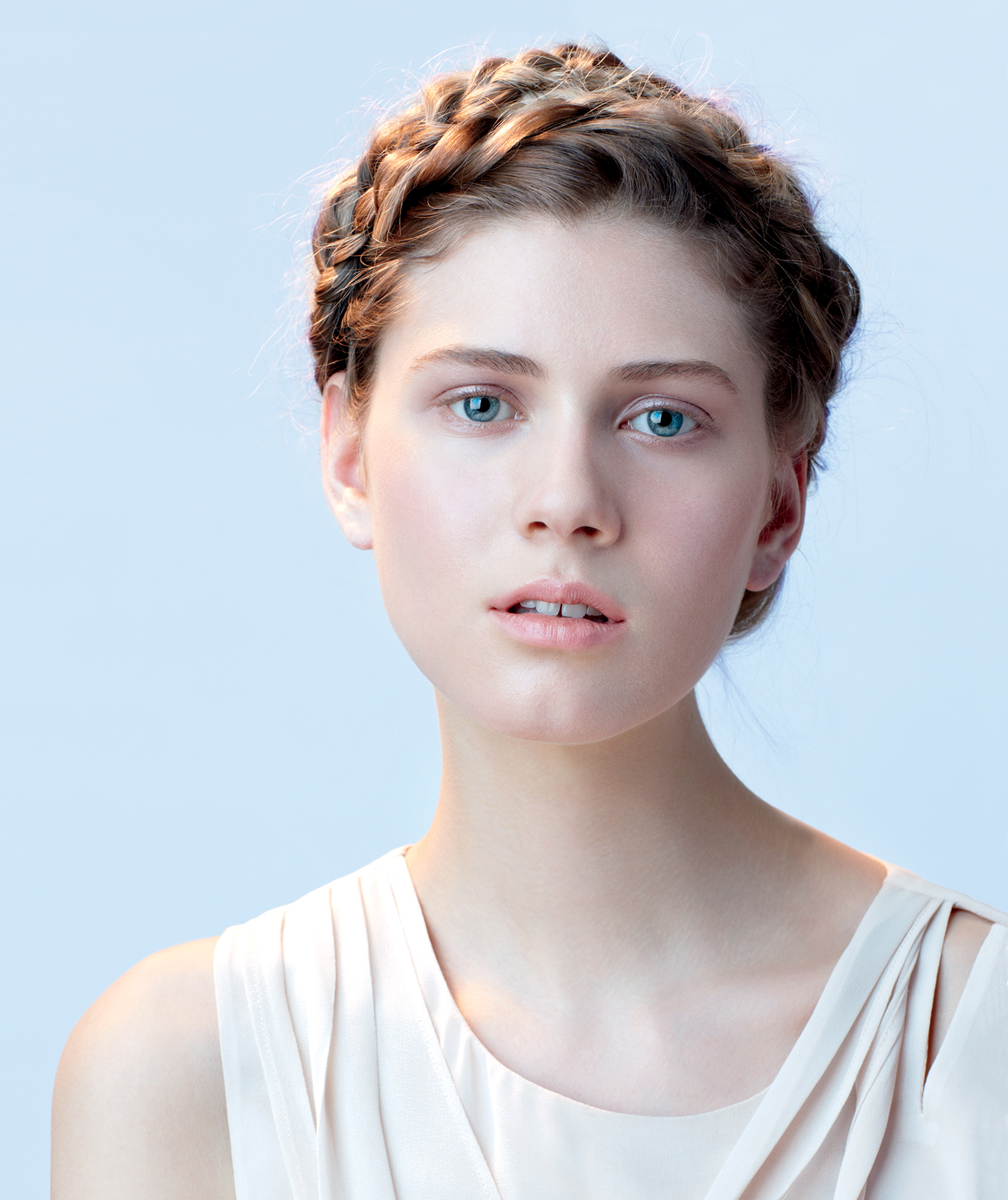 Model wearing a braided crown hairstyle