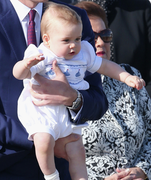 Prince George in white cotton romper