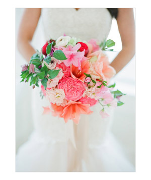 Bride with red and pink bouquet