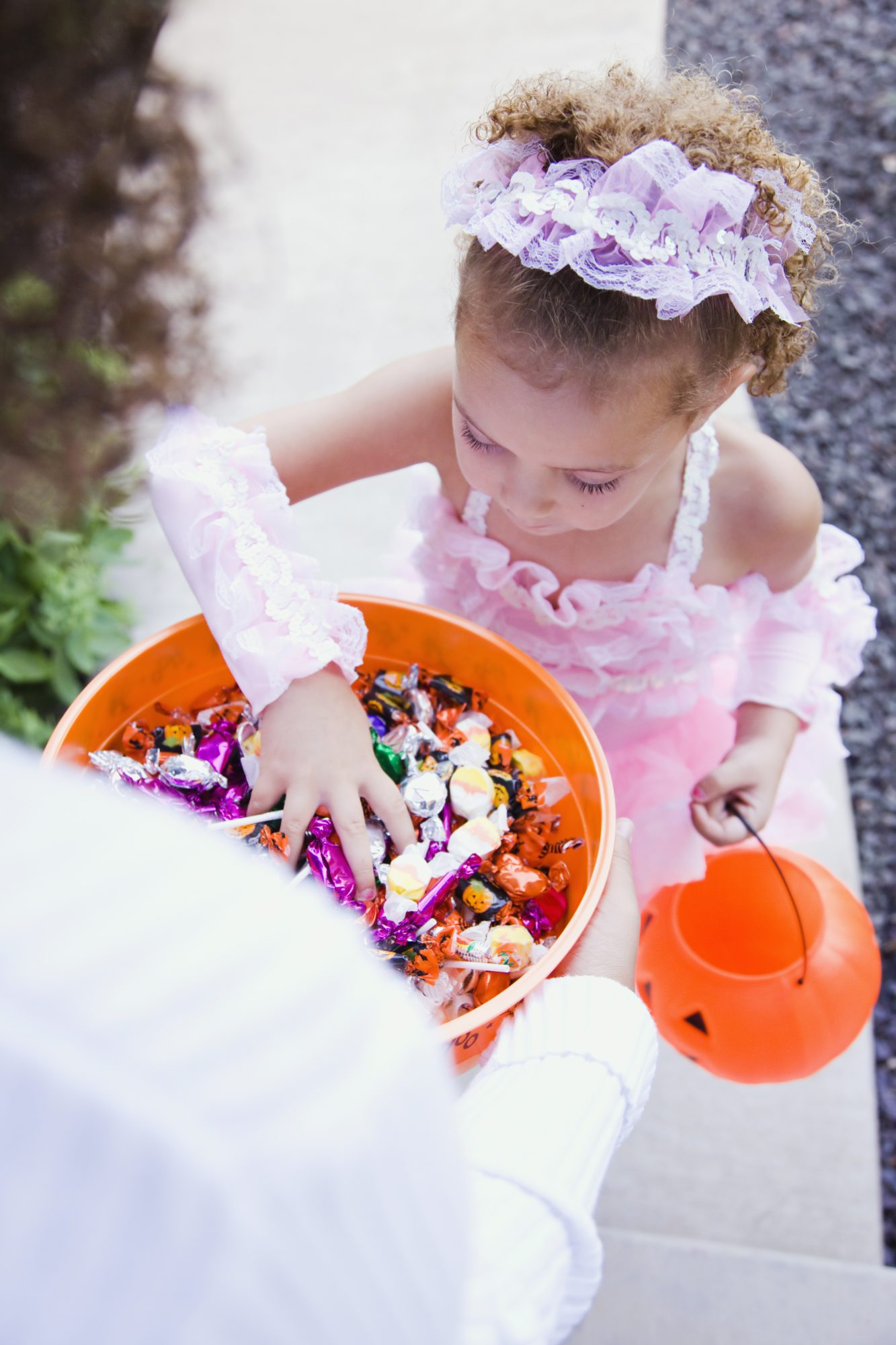 Girl in princess costume trick or treating