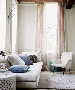 Beige room with light pink curtains & 16 Apartment Decorating Ideas | Real Simple