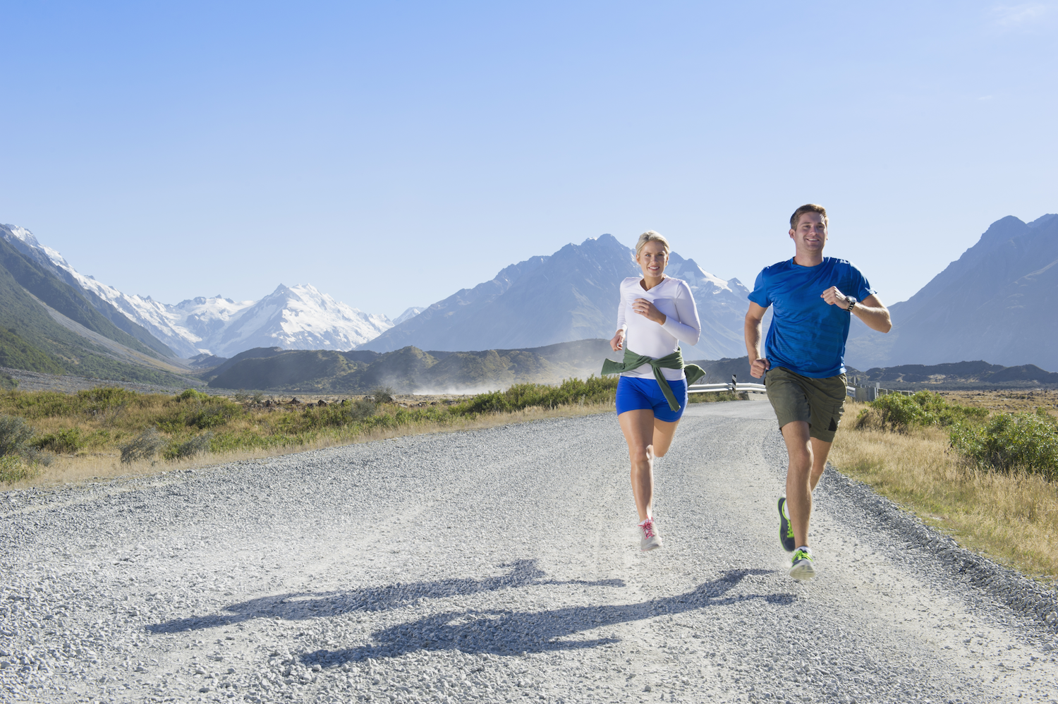 Two people running in the mountains