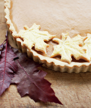 Pumpkin pie with maple leaf cookies