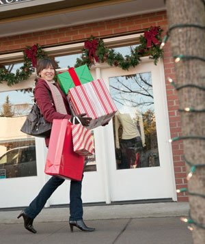 Woman Christmas shopping carrying bags and boxes