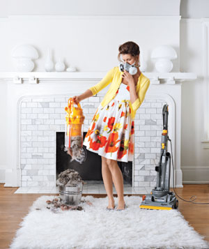 Woman emptying a vacuum