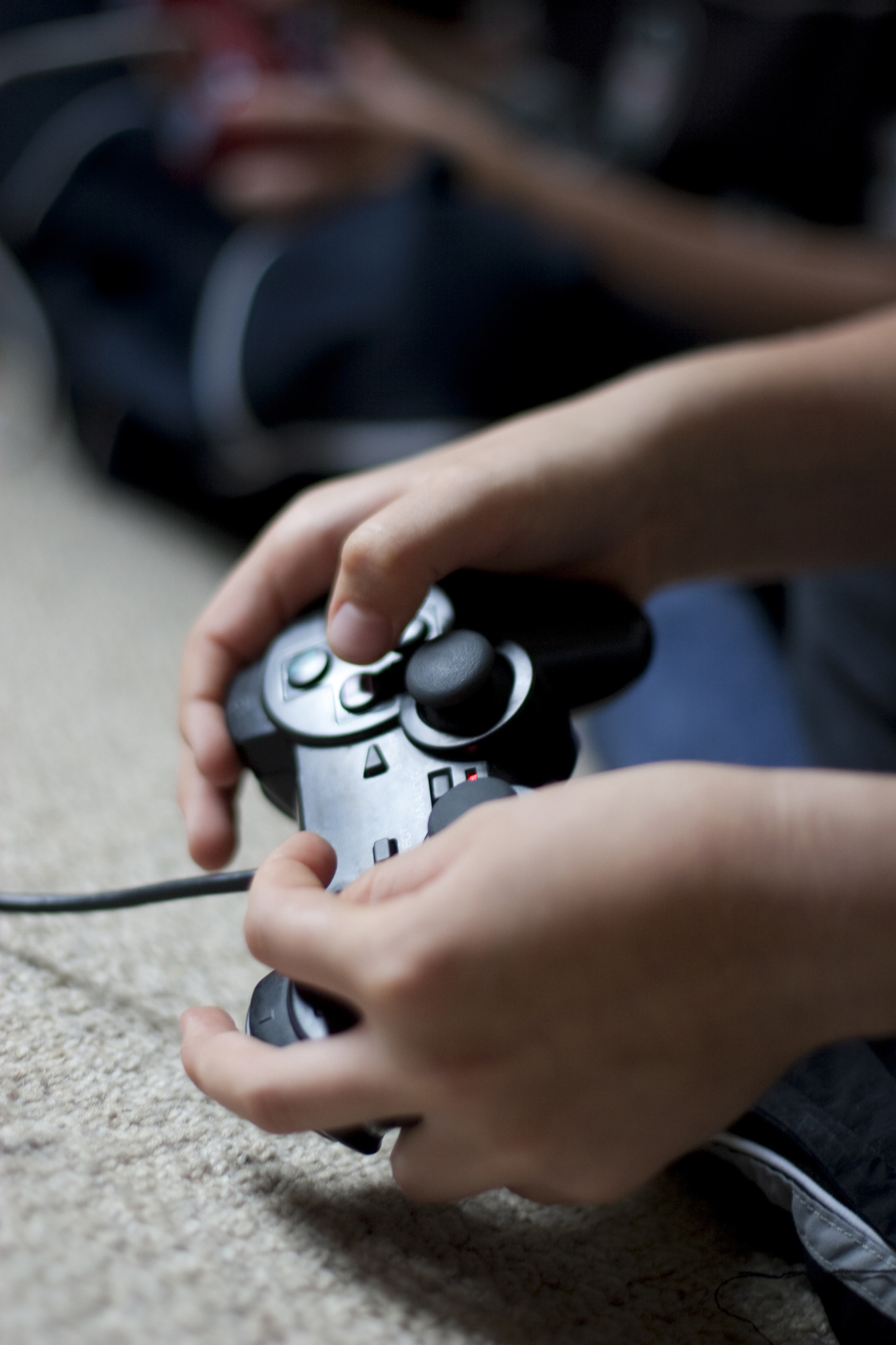 Child holding video game controller