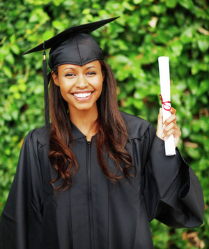 Woman in cap and gown with diploma