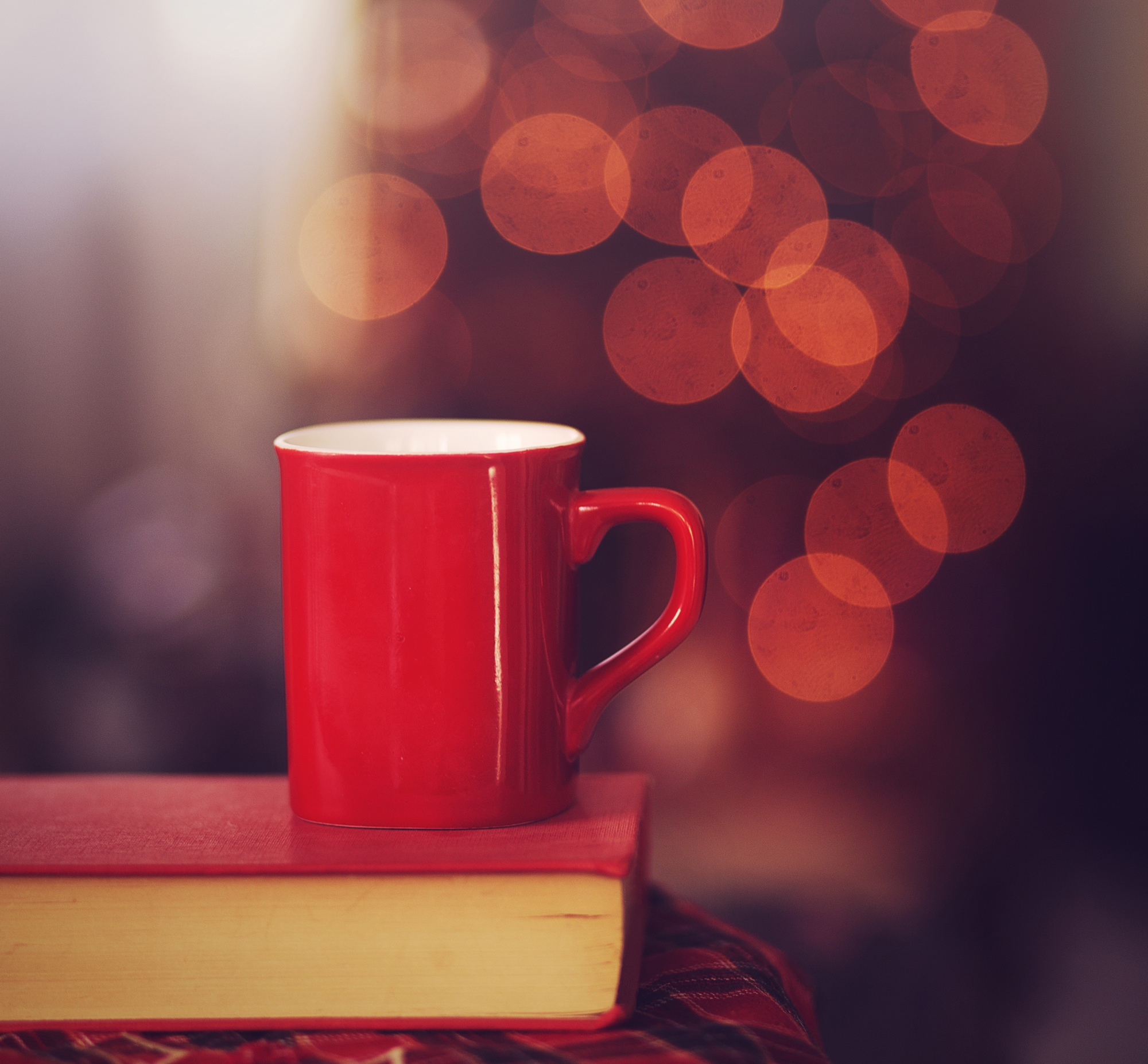Red coffee cup on red book