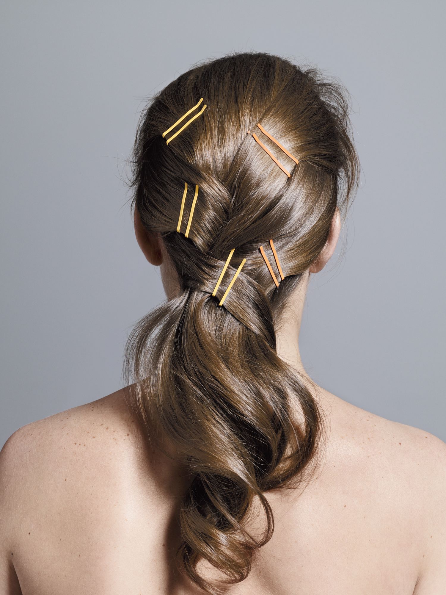 Model with loose braid and bobby pins