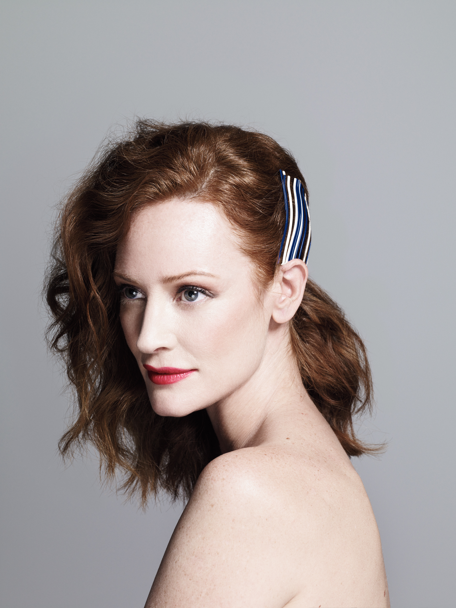 Model with hair half-up, half-down
