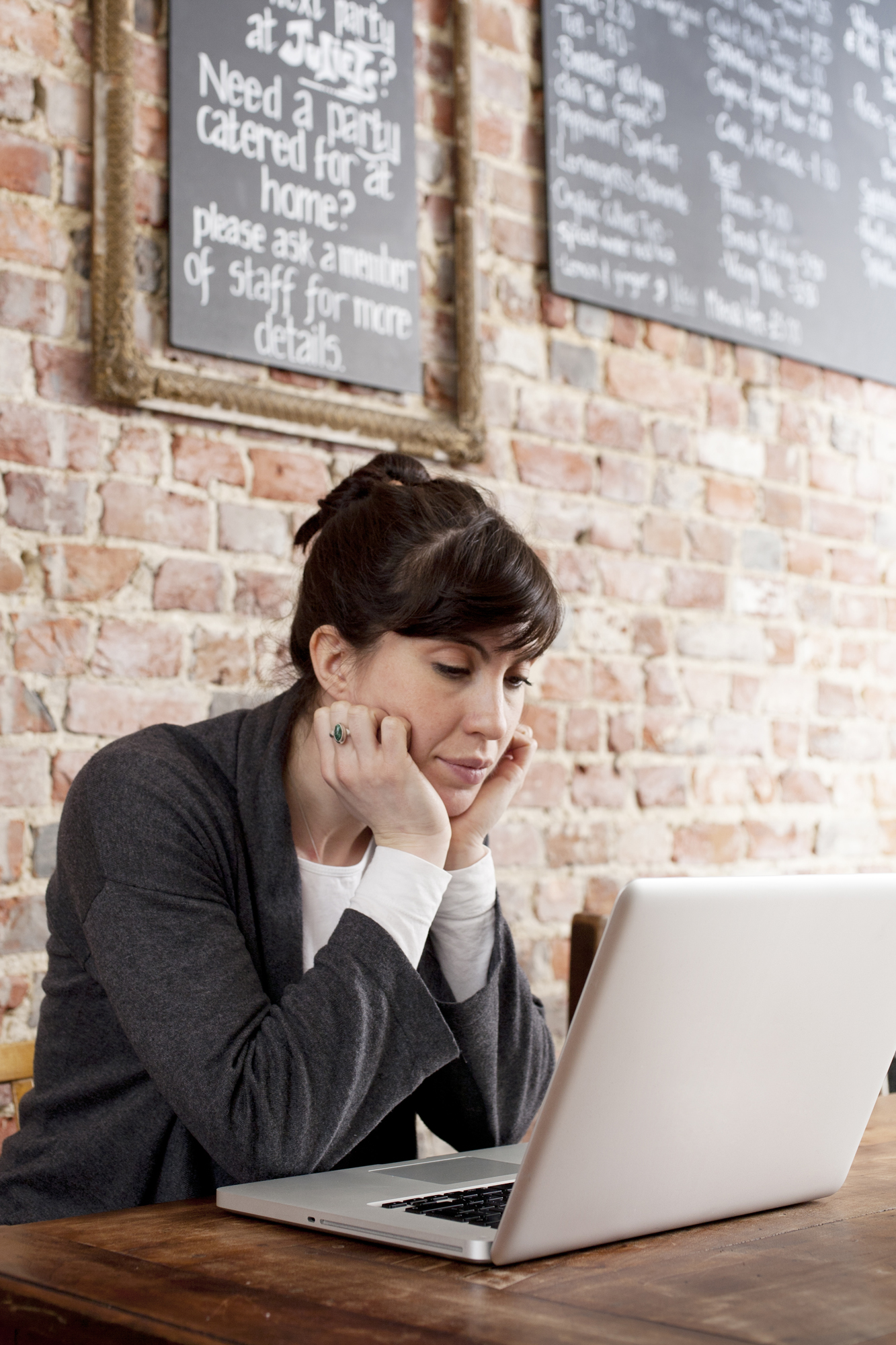 woman-laptop-cafe-exposed-brick