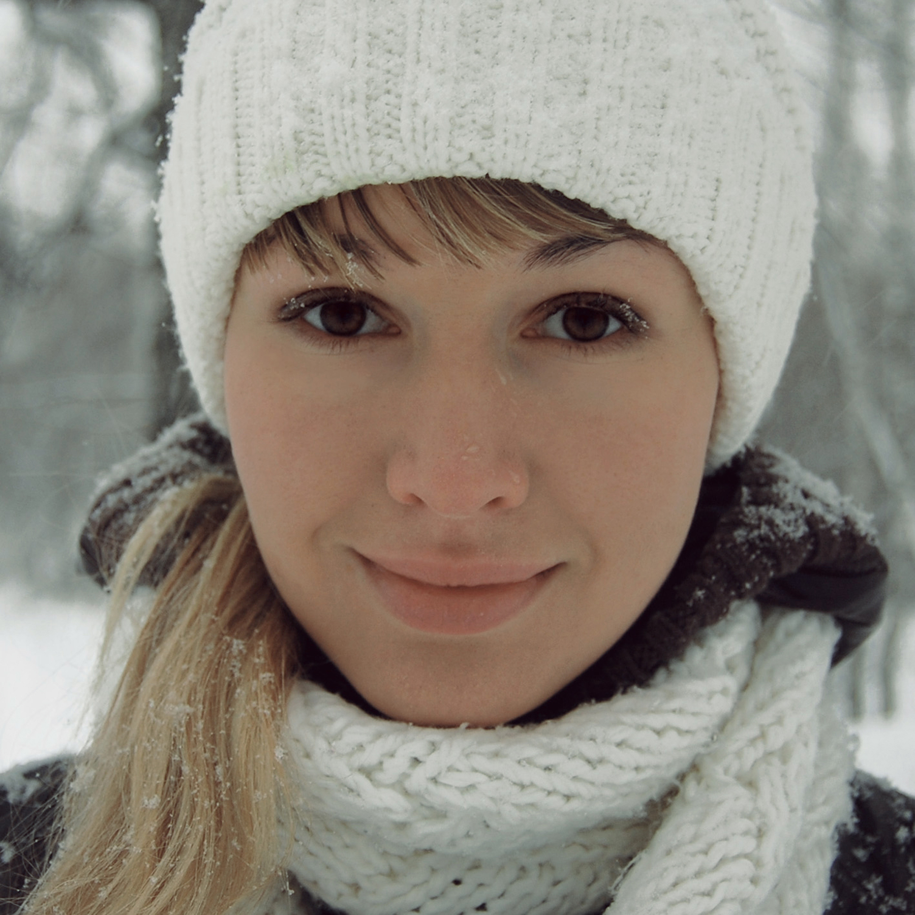 Woman in winter hat and scarf