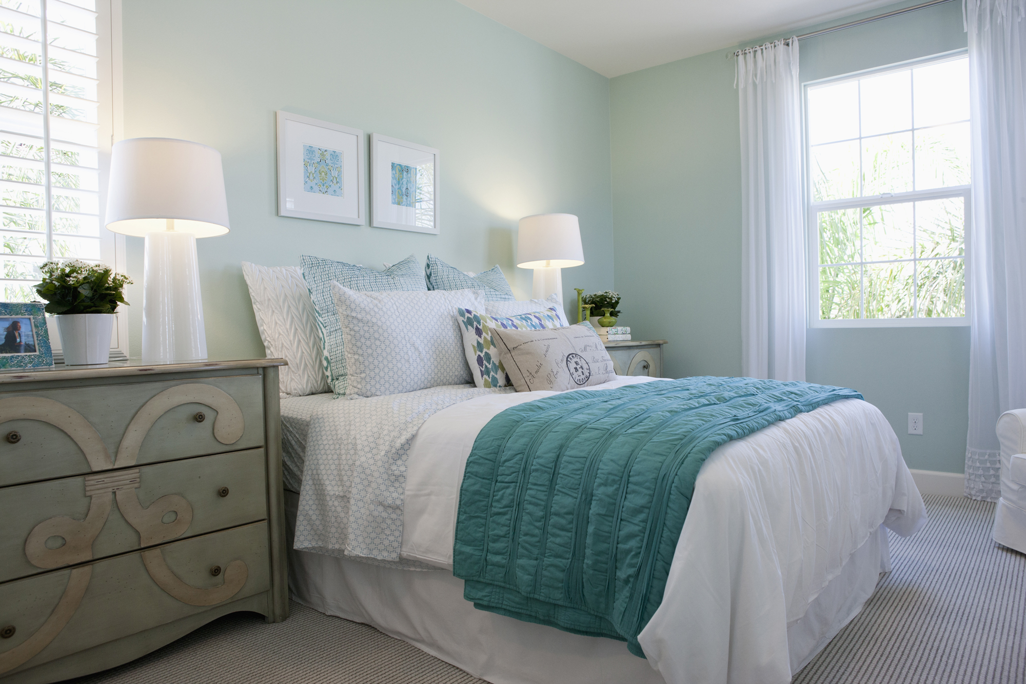 Blue bedroom with white lamps