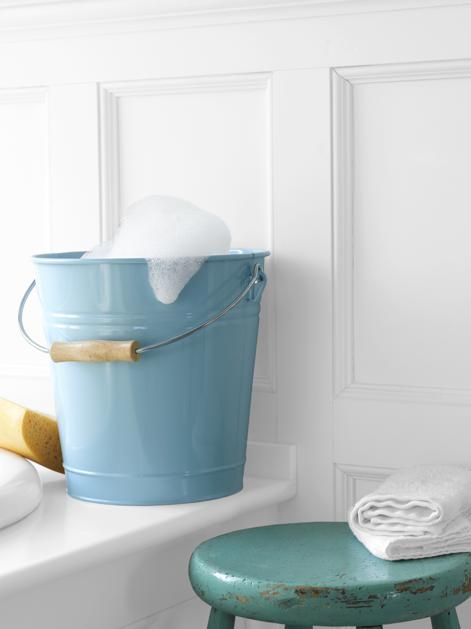 Pale blue bucket with suds