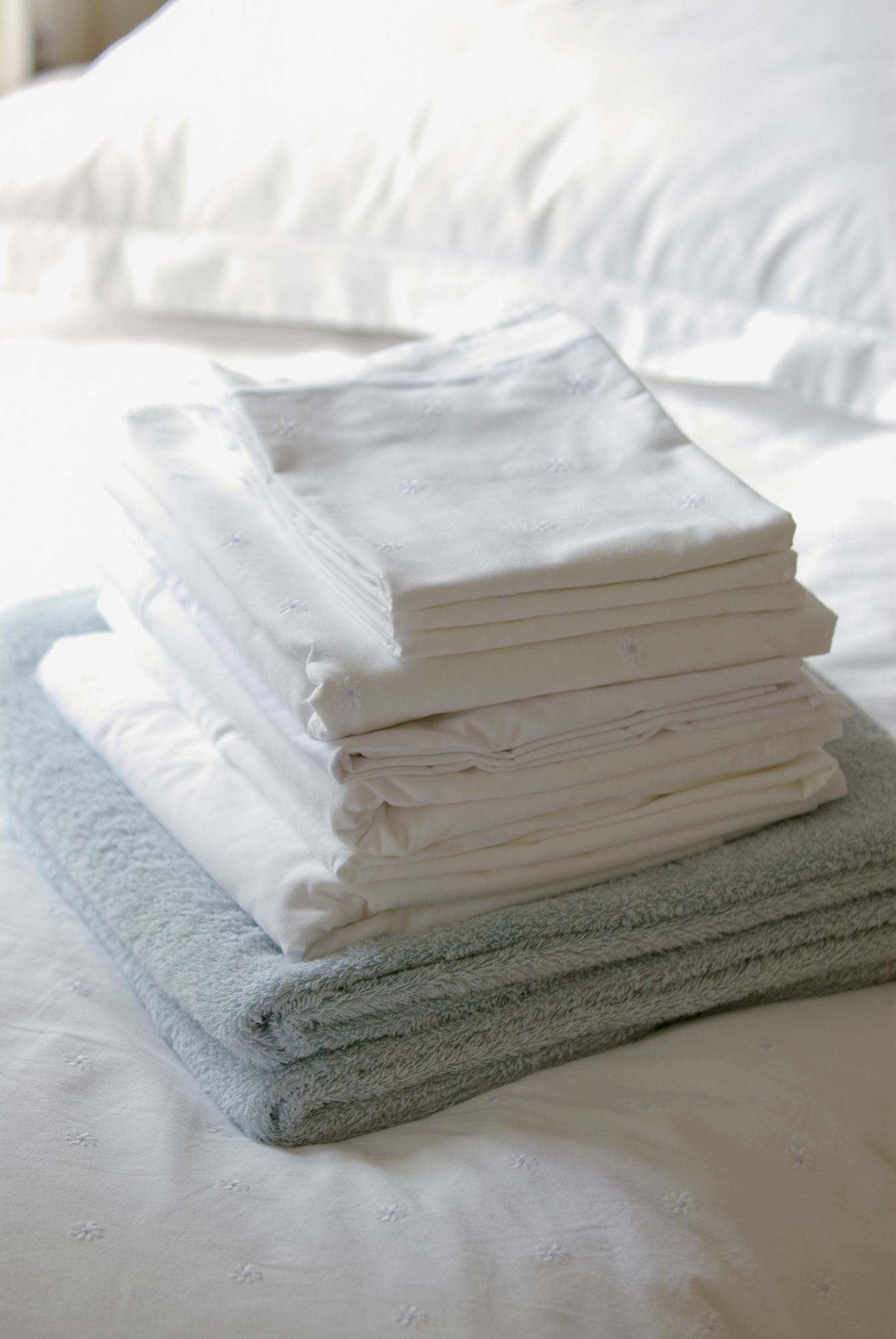 Stack of folded sheets and towels