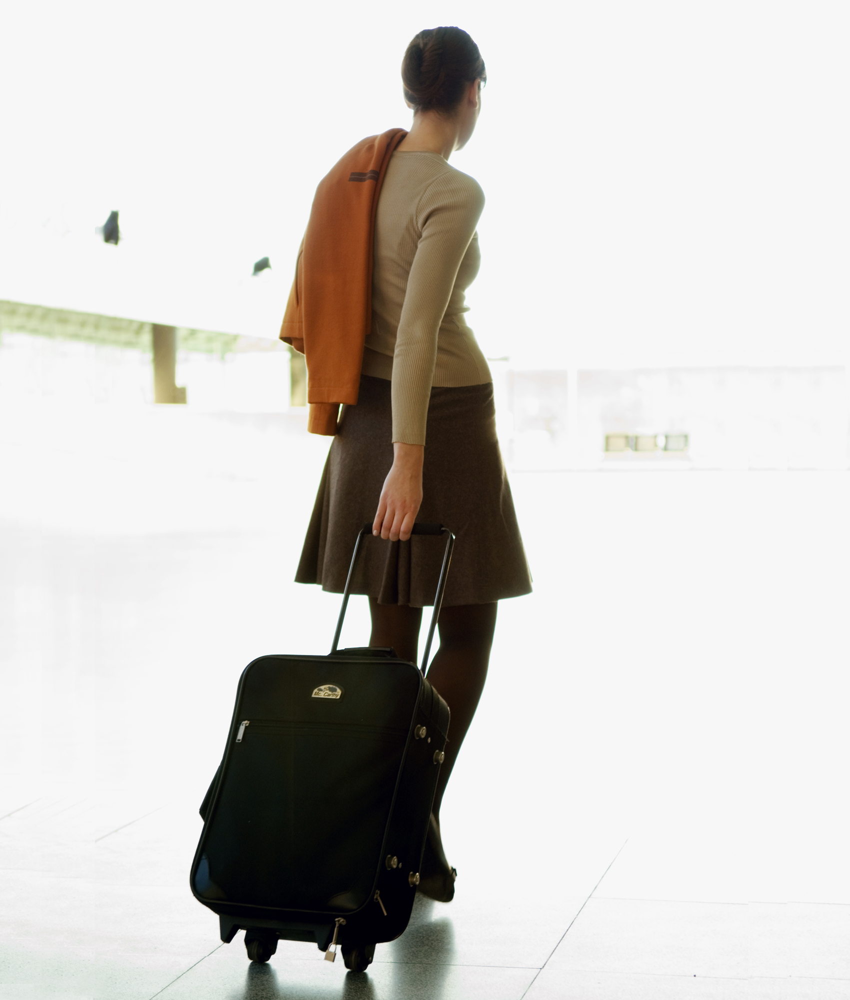 Woman with rolling suitcase