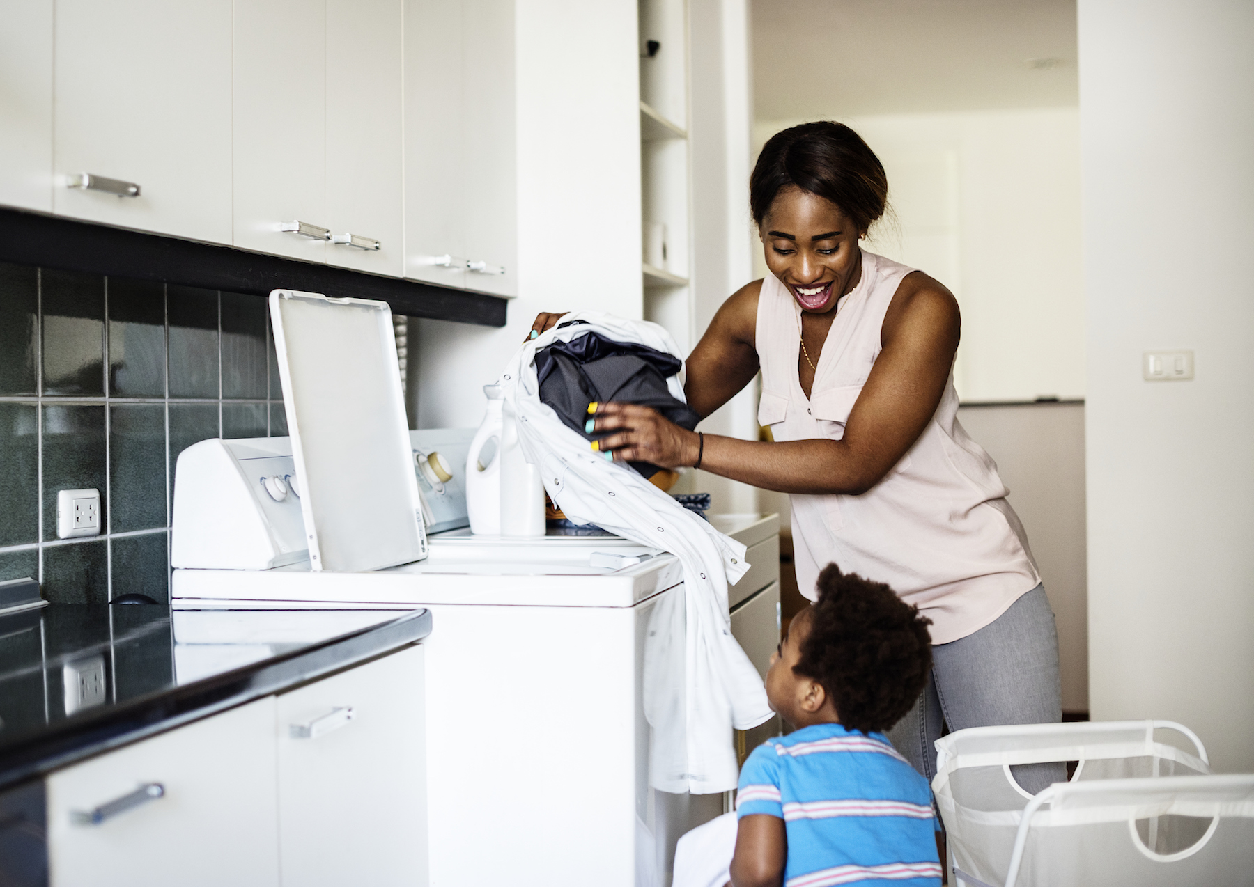 Mom and Son Doing Laundry