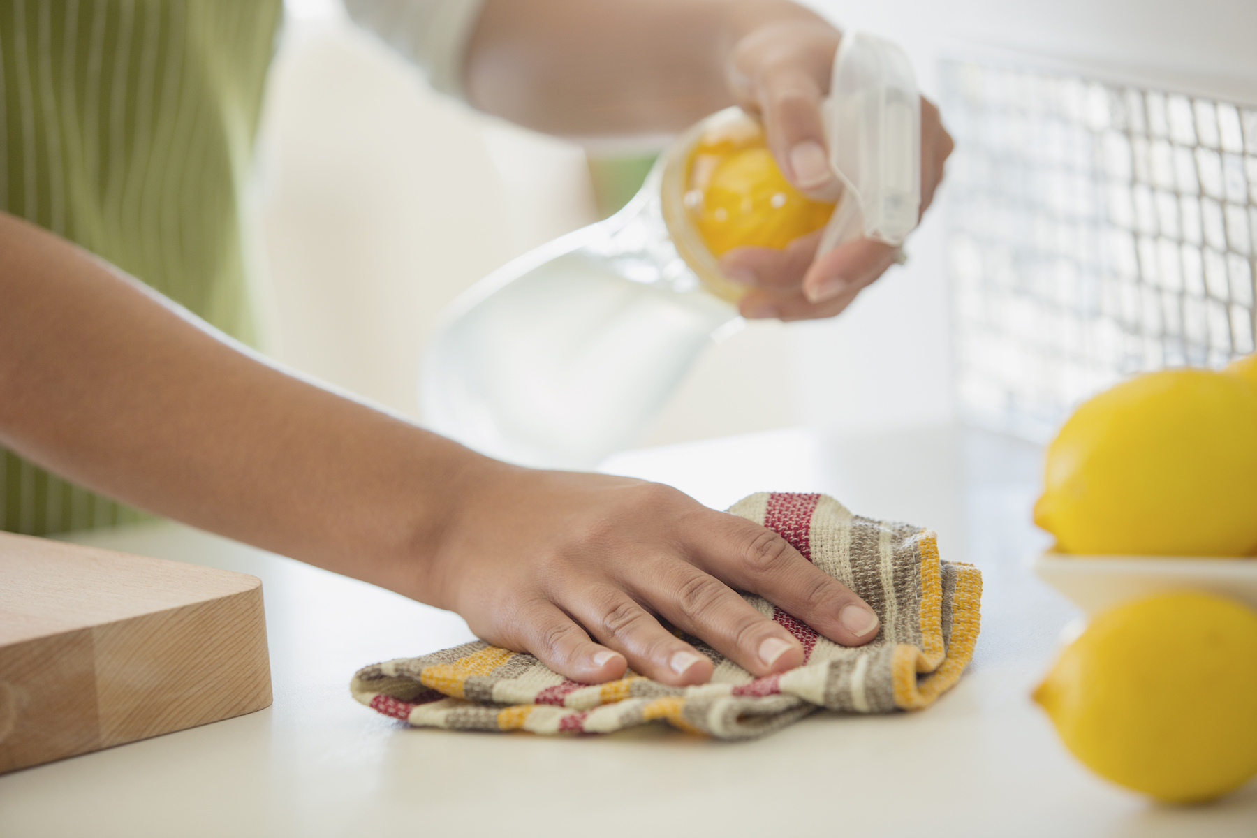 Homemade Cleaning Solution Recipes, woman scrubbing counter