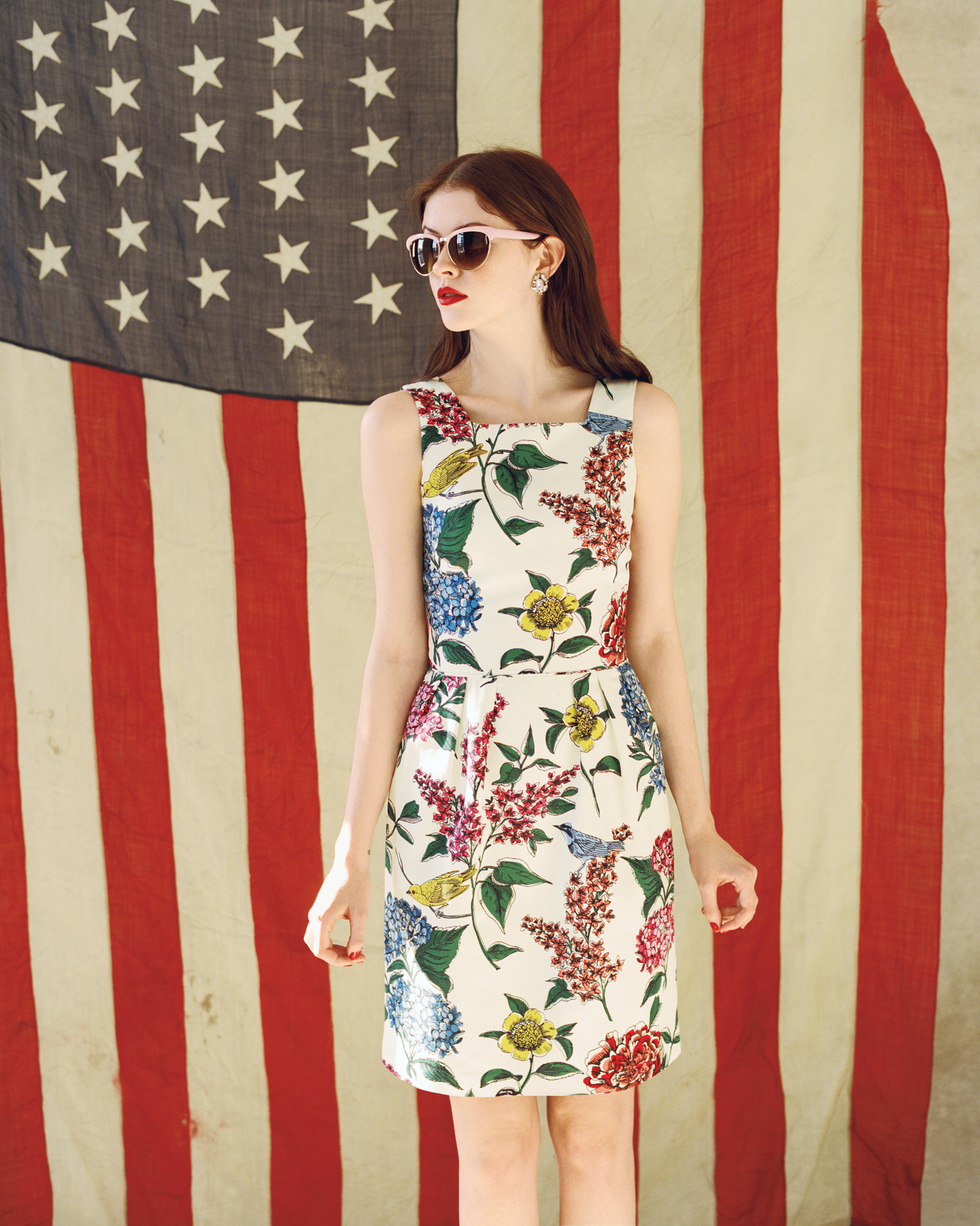Model wearing floral dress and cateye sunglasses