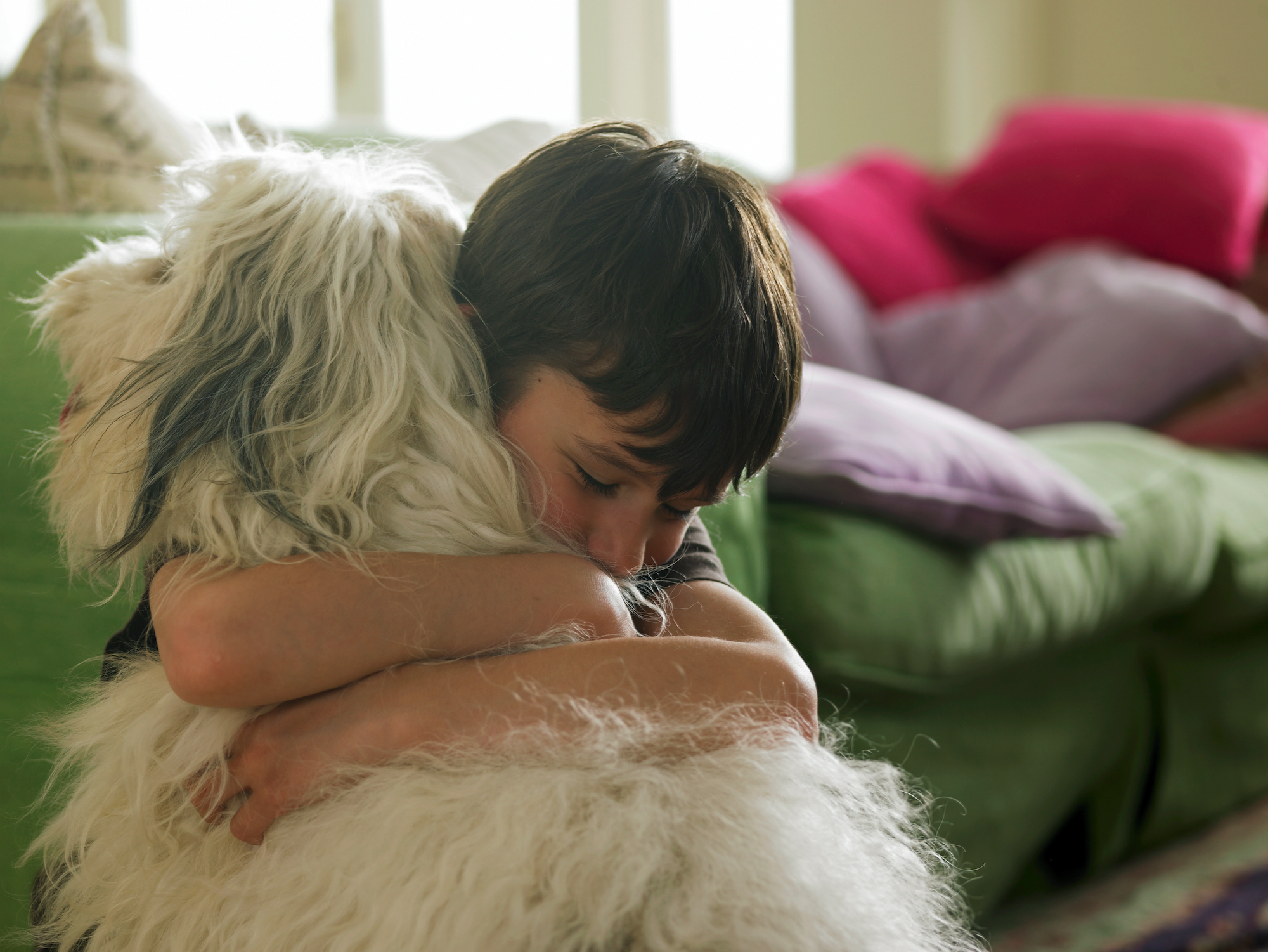 The Truth About Your Kids' Bond With the Family Pet