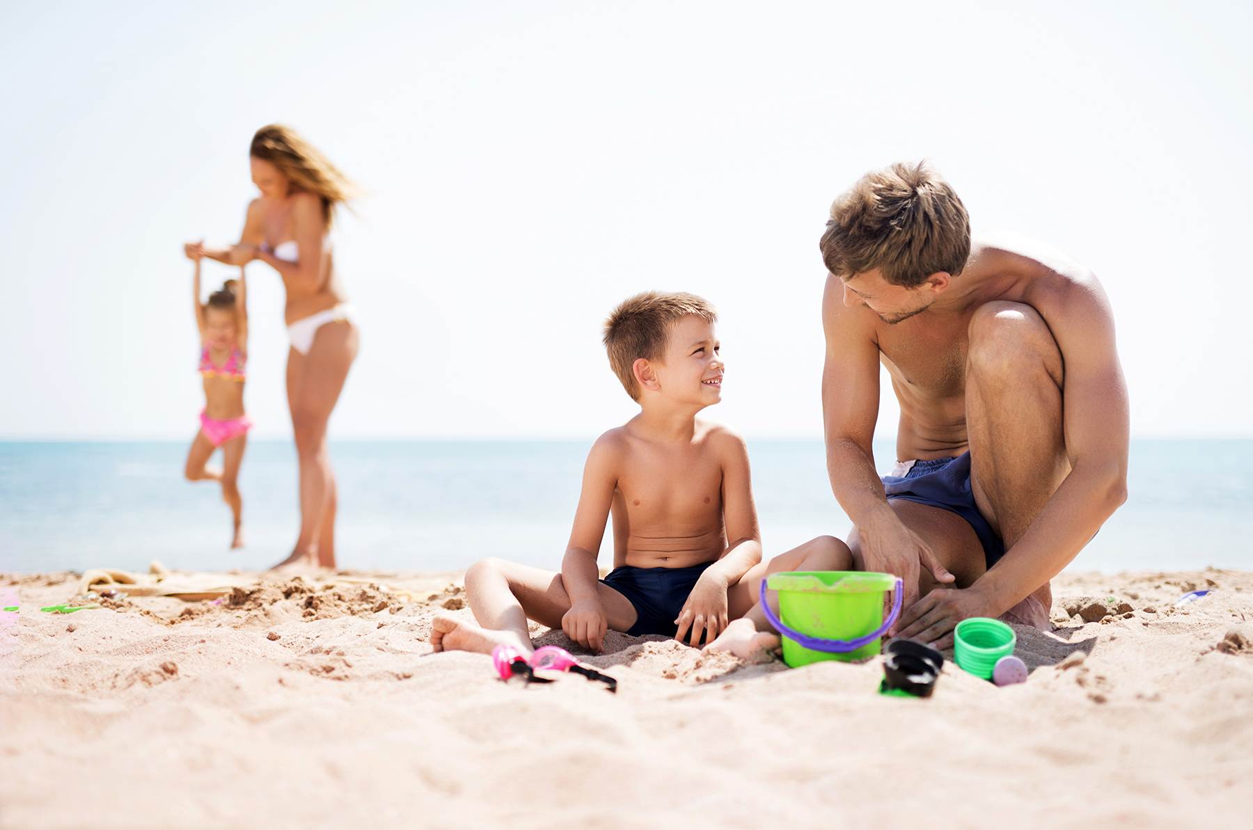 Family playing on beach