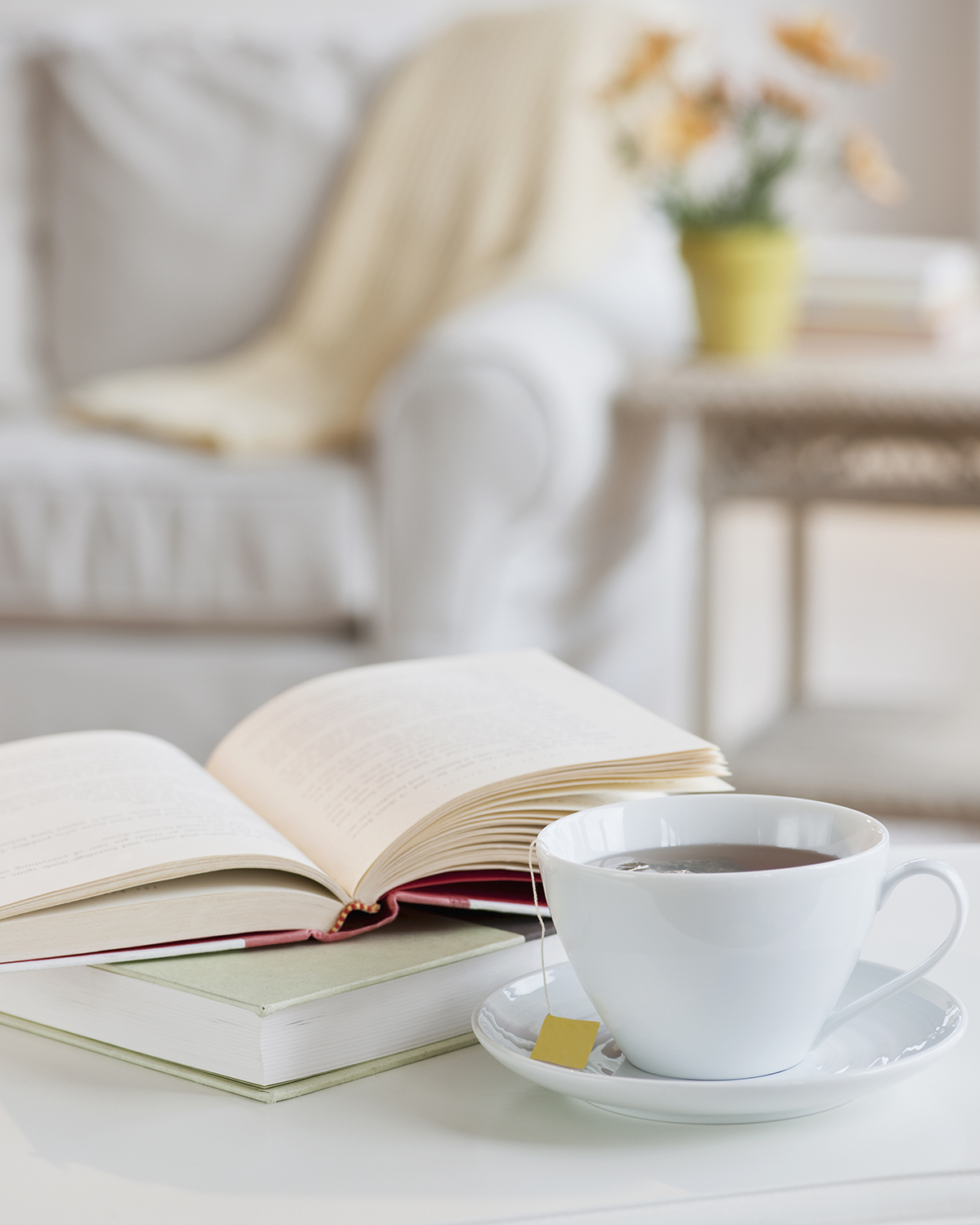Coffee and book on a table.