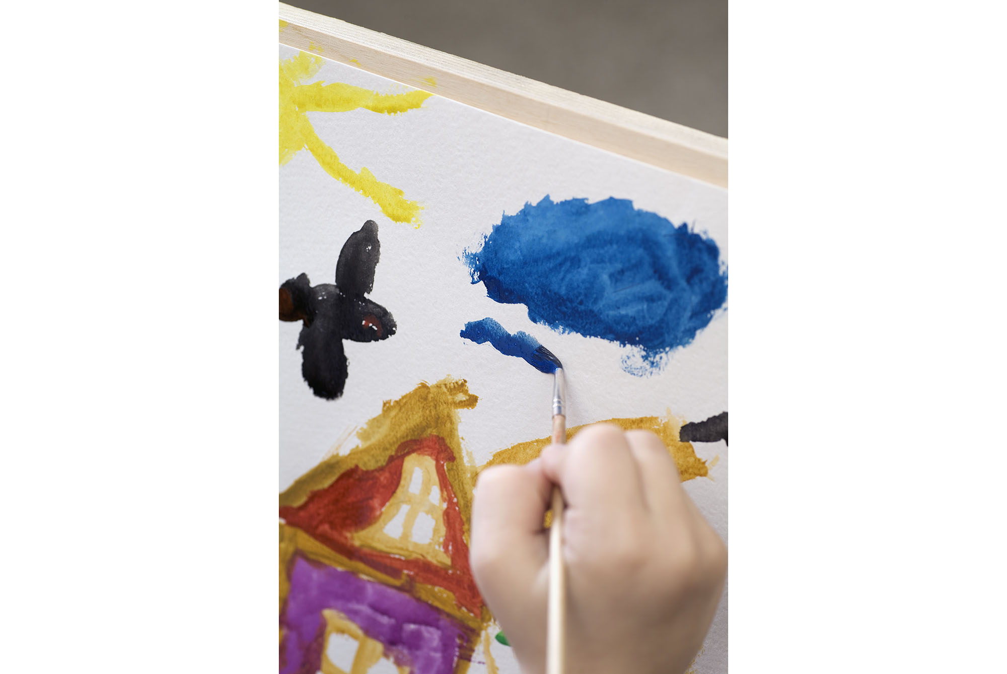 Close-up of child painting