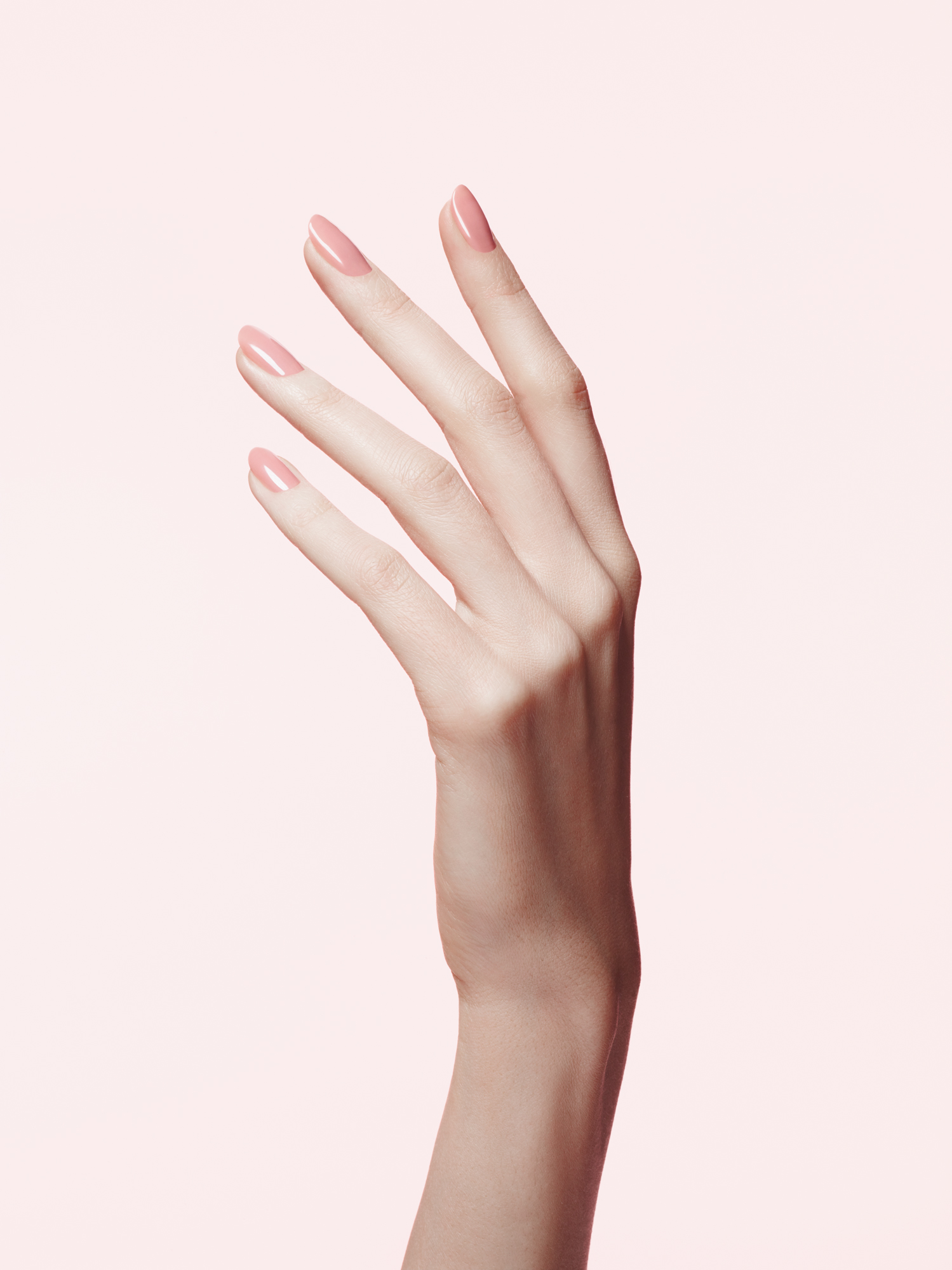 Hand with pink gel manicure