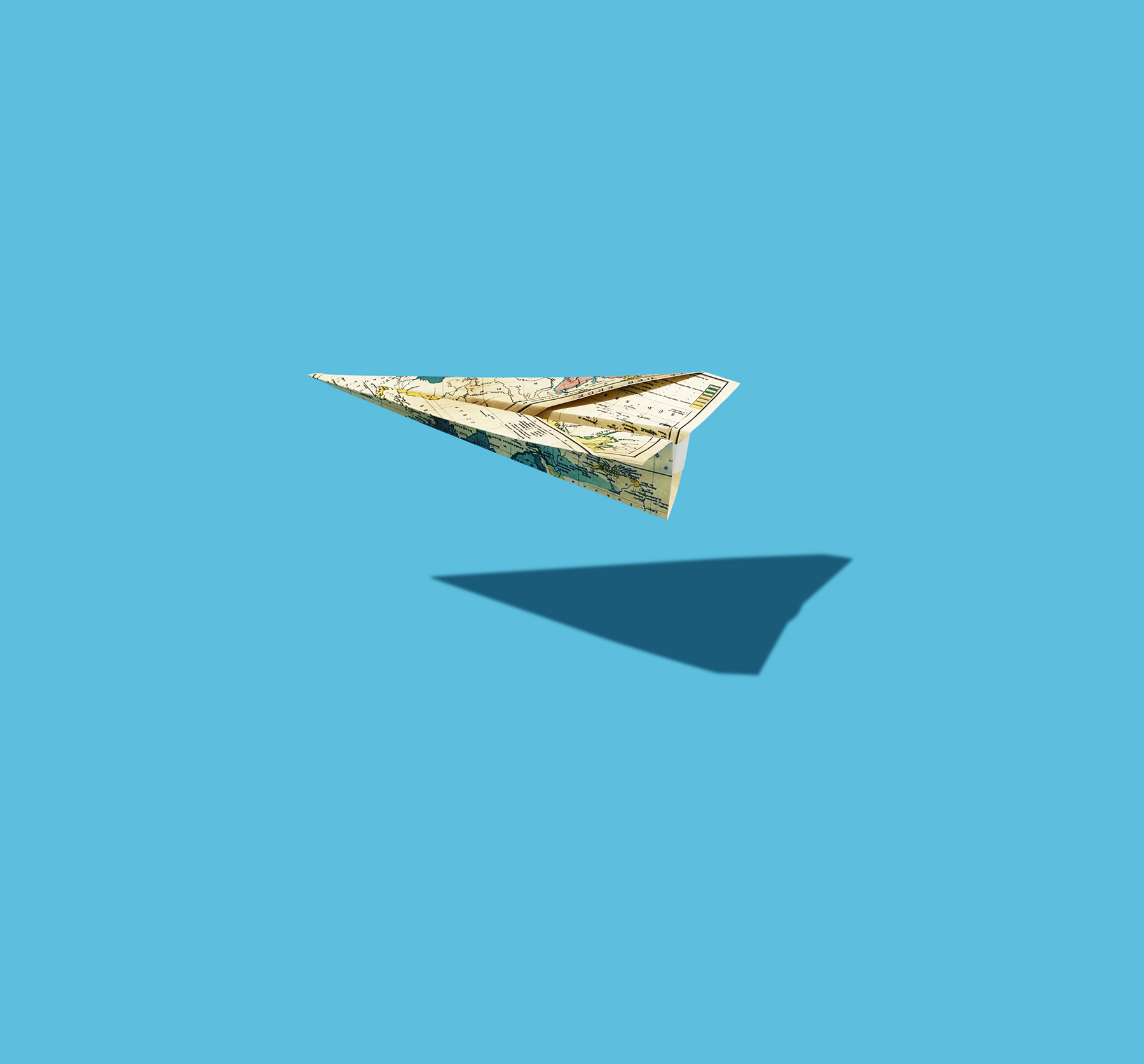 Paper plane on blue