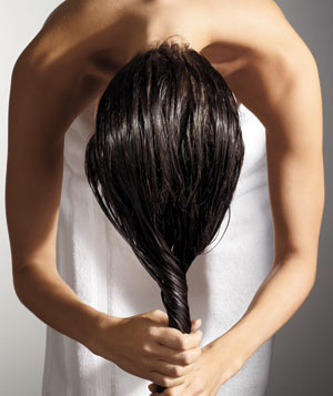 Woman ringing out her wet hair