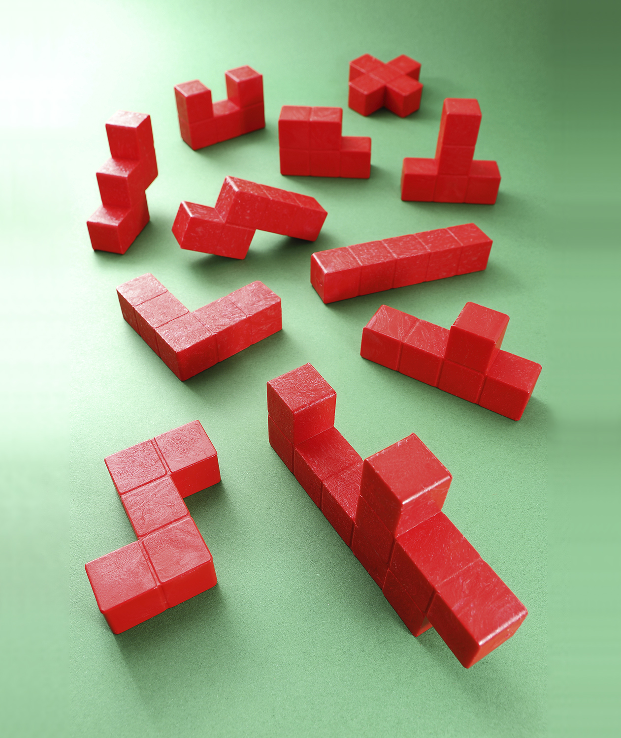 Red Tetris pieces on green background