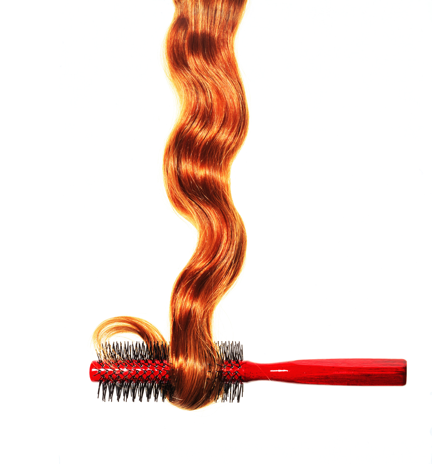 Long red hair and brush
