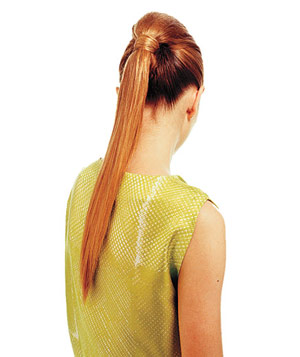 Model with auburn hair in a high ponytail
