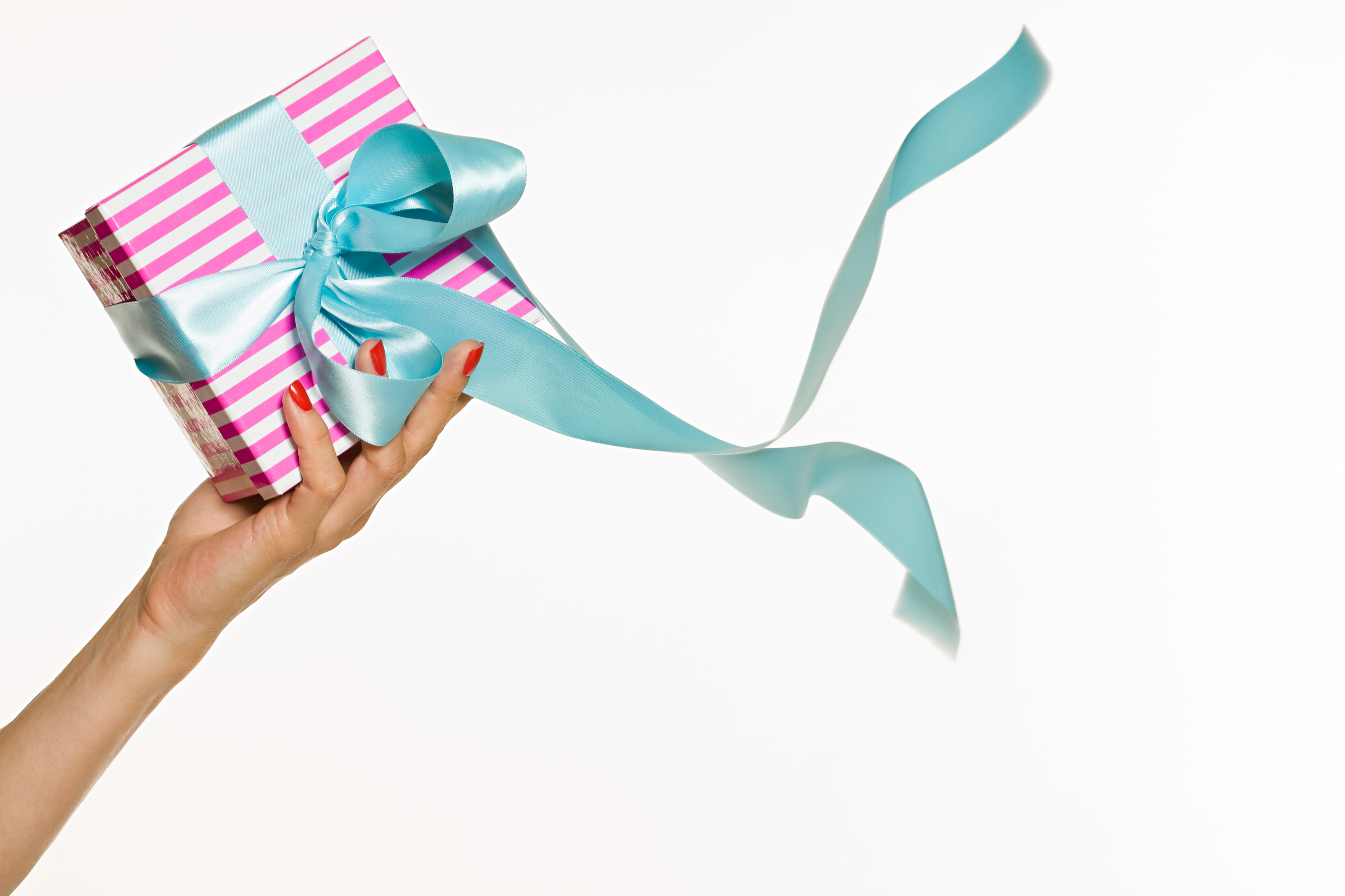 Female hand holding a gift