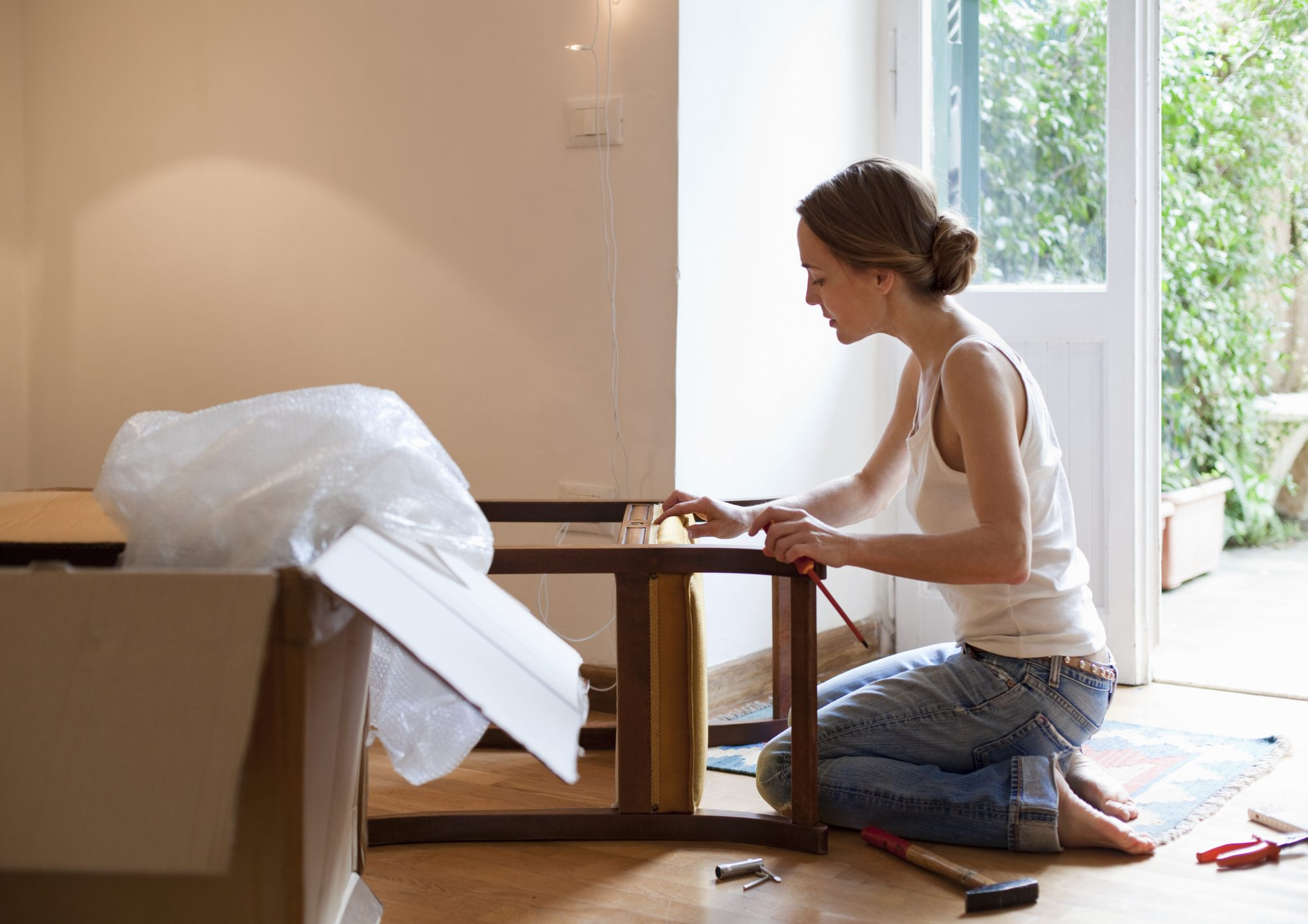 woman-fixing-piece-furniture