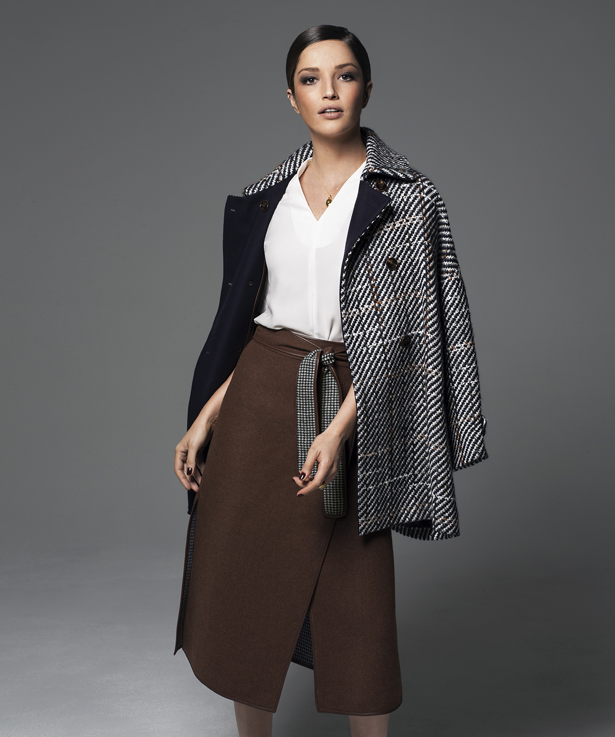 Model wearing wool coat and brown skirt