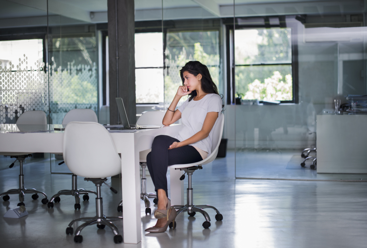 woman-sitting-at-conference-table