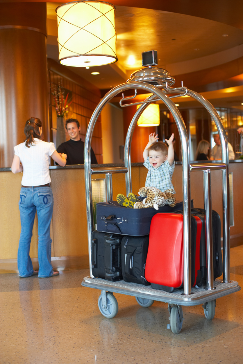 kid on luggage cart