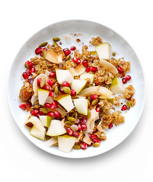 Granola Bowl With Pomegranate Seeds, Pear, and Toasted Coconut