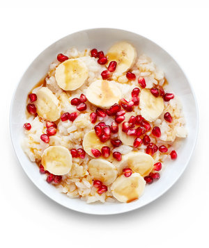 Rice Pudding With Banana, Pomegranate Seeds, and Caramel
