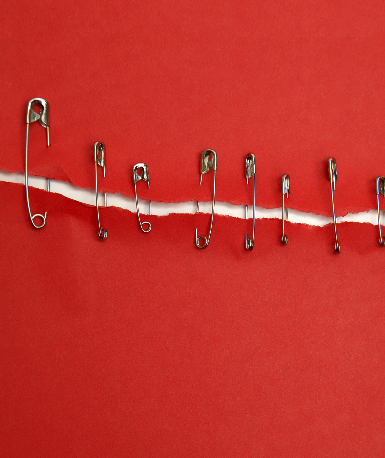 Safety pins holding fabric together