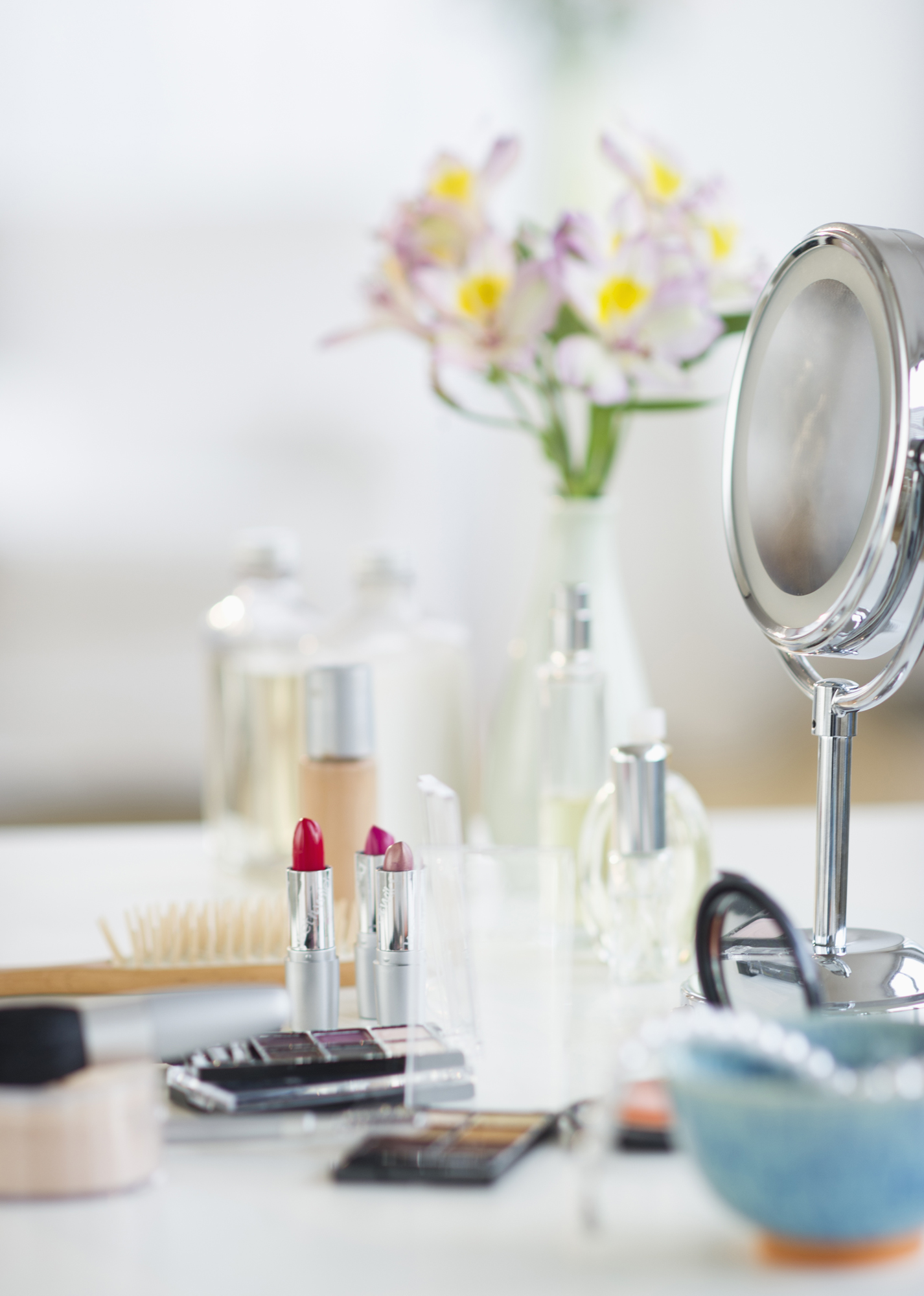Makeup, cosmetics, mirror on white table