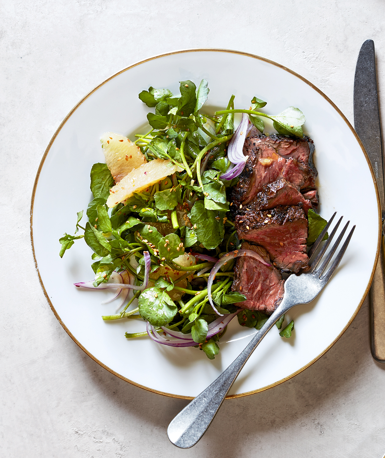 Hanger Steaks with Watercress, Grapefruit, and Red Onion Salad