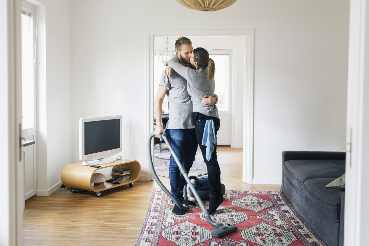 Couple Vacuuming
