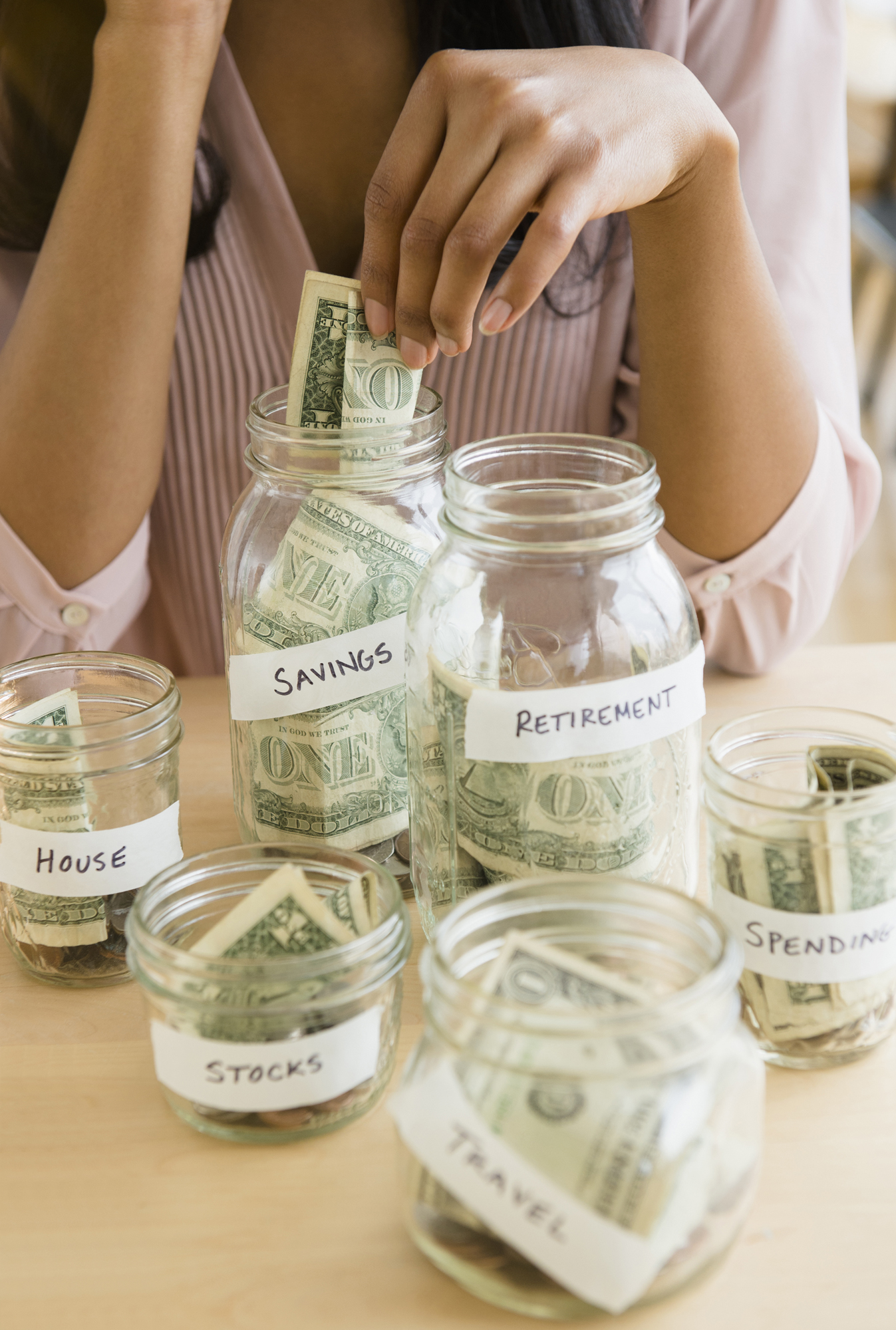 Money separated in jars for saving
