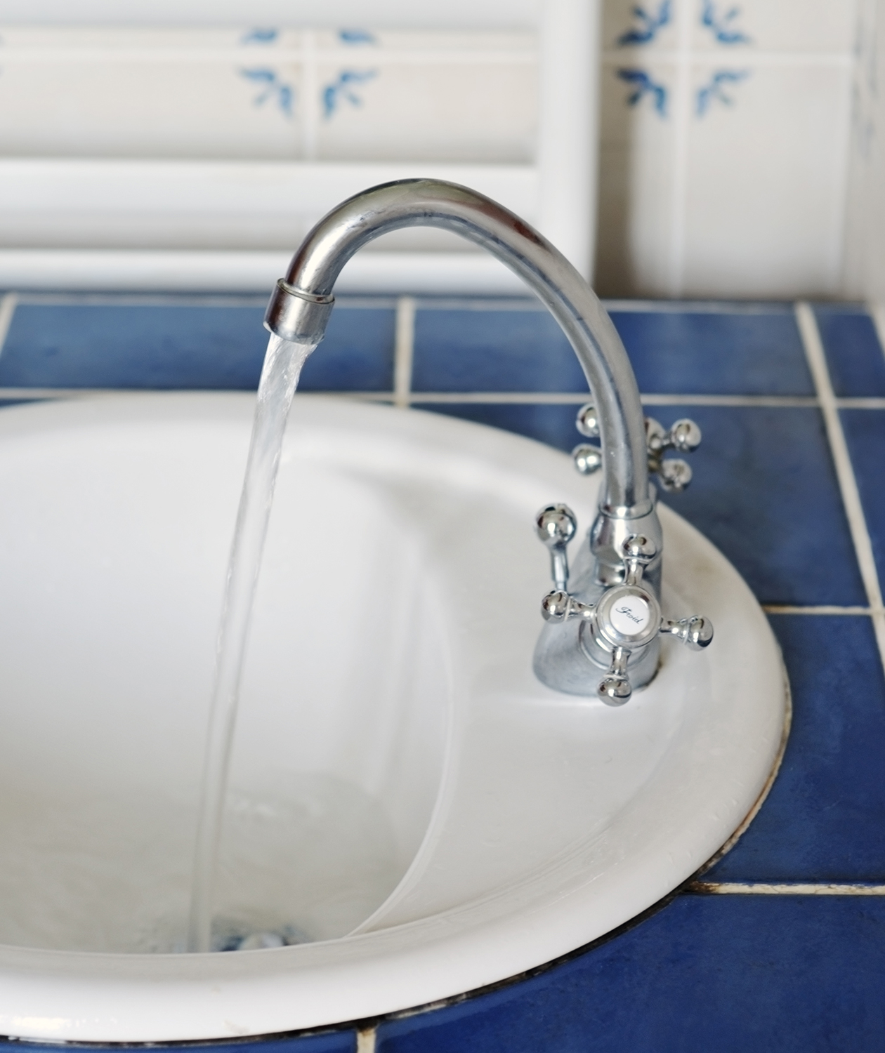 White wash basin and blue tiles