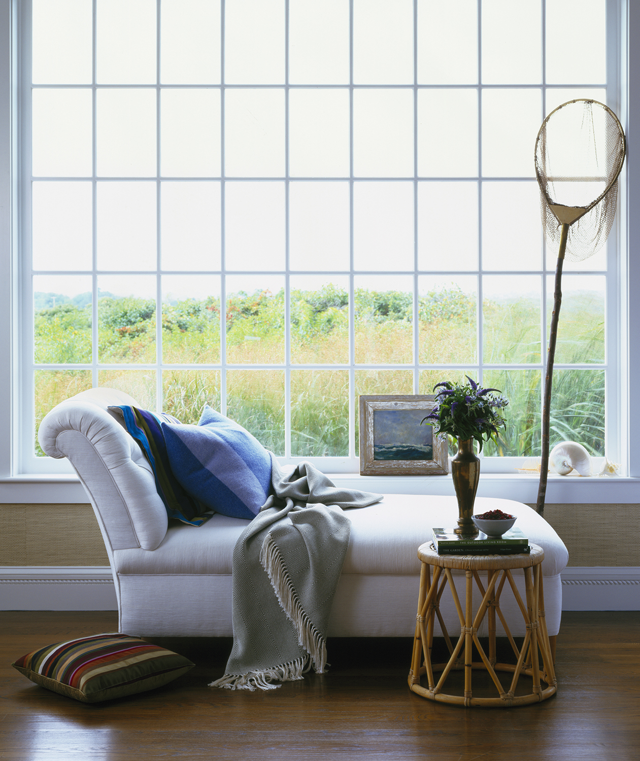 Chaise in front of huge window
