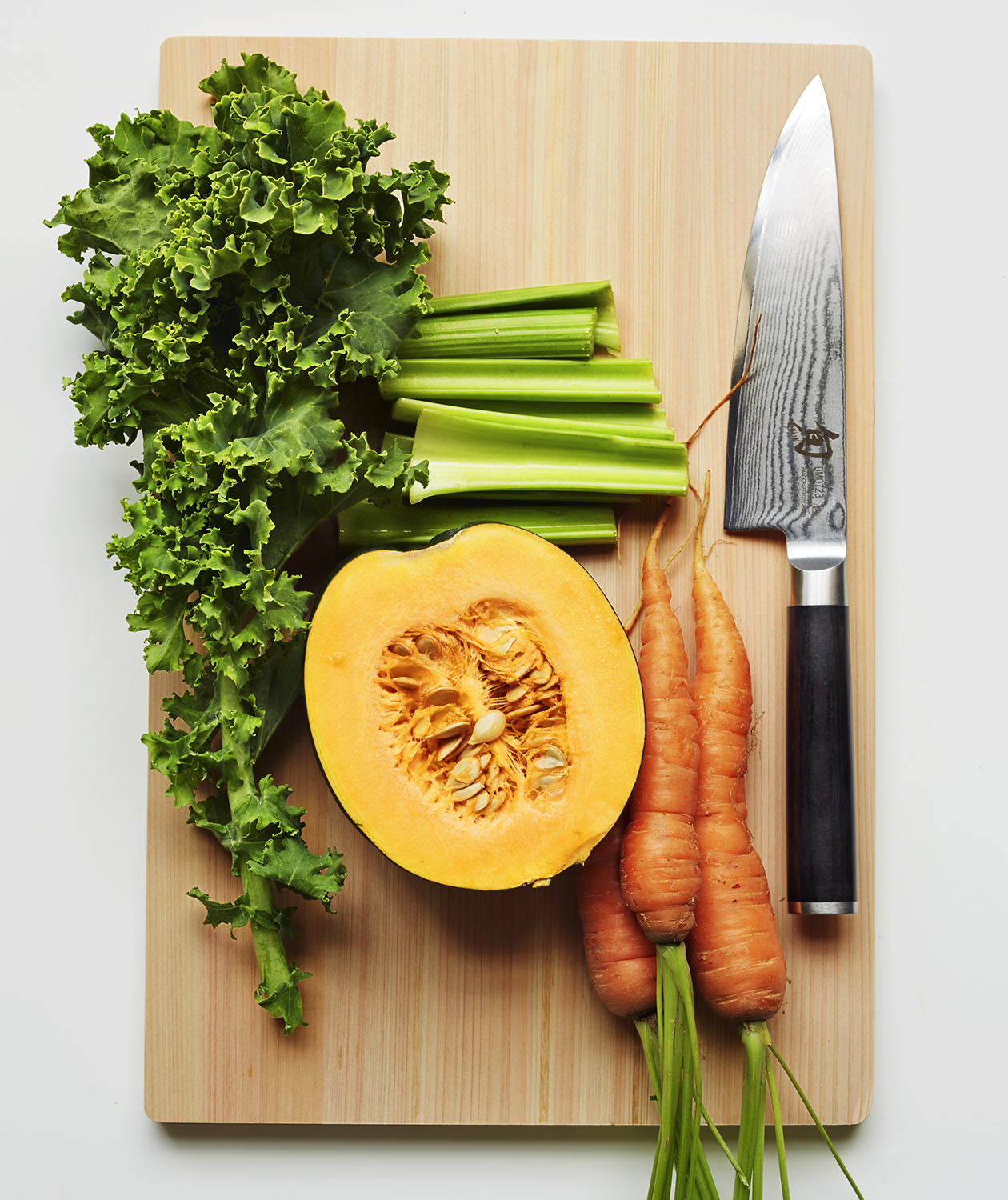 Cutting board, knife, vegetables