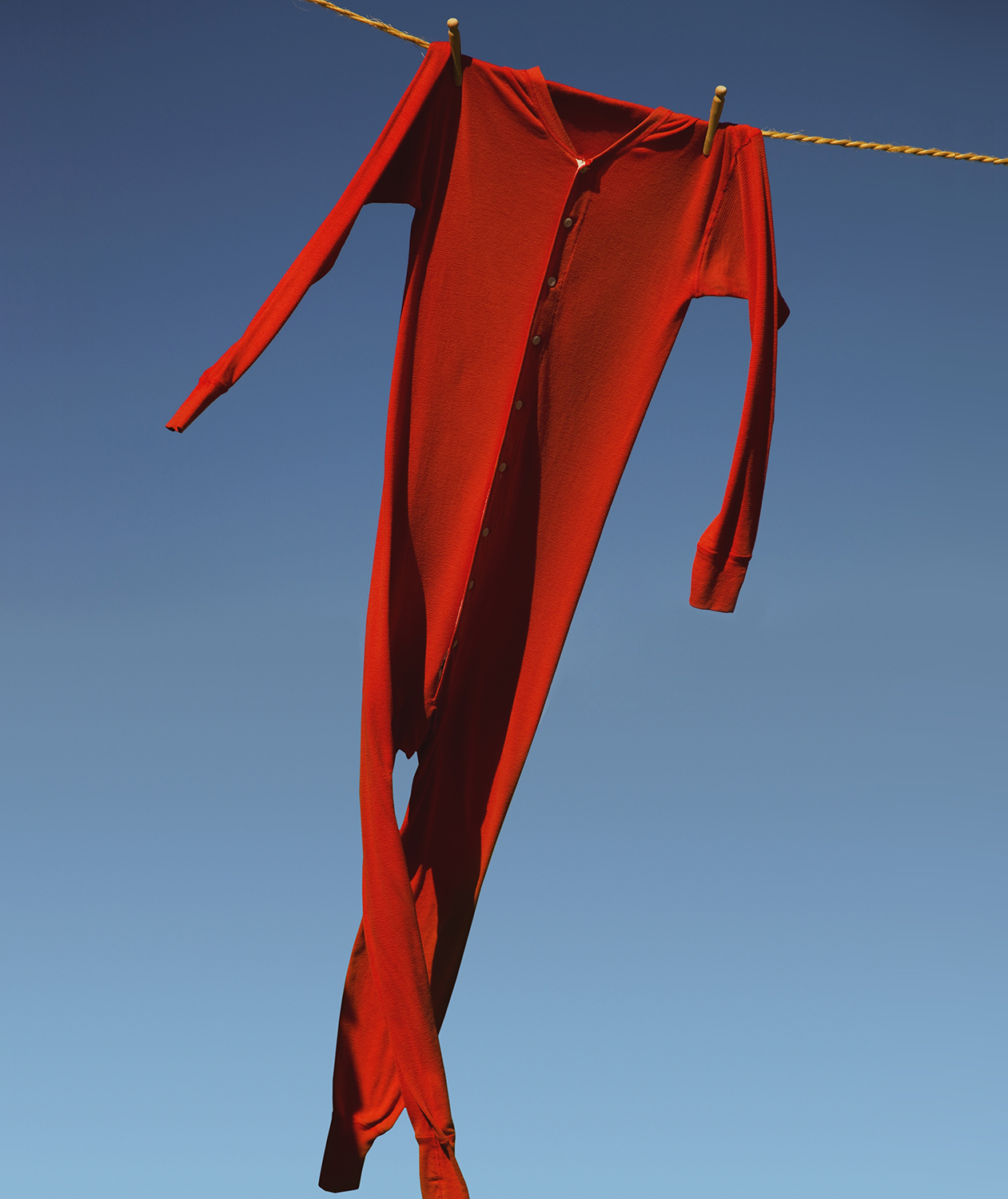 Red long johns on clothesline